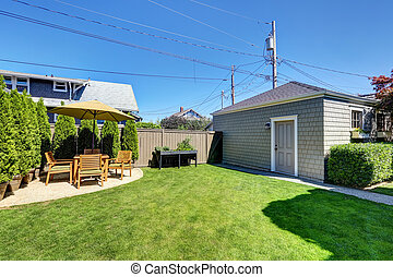 Nice green shed in the backyard of American craftsman house.