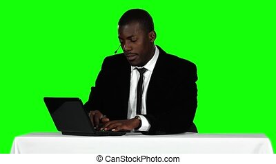 Call center operator accepts the order online Green screen -...