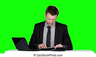 Examining business documets Green screen - Examining...