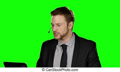 Female operator talking via headset. Green screen - Female...