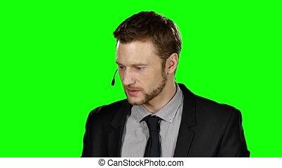 Call center operator. Green screen