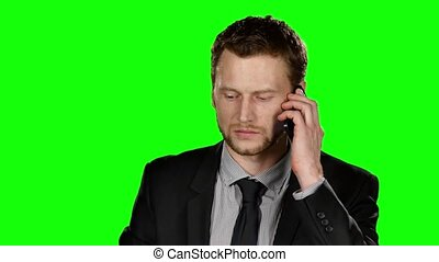 Businessman talking on the phone. Green screen - Businessman...