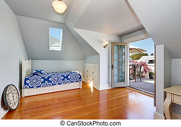 Vaulted ceiling kids bedroom in the attic with exit to the roof terrace