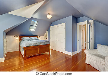 Lavender interior of attic bedroom with queen size bed