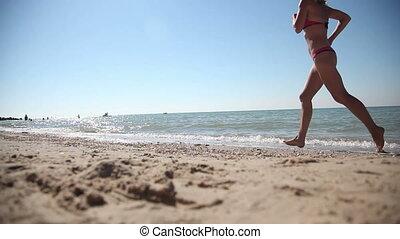 Woman Runs Along the Seashore. Full HD
