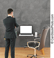 Man looking at workplace - Thoughtful businessman in suit...