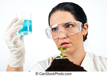 Scientist analysing or examine liquid - Scientist woman...
