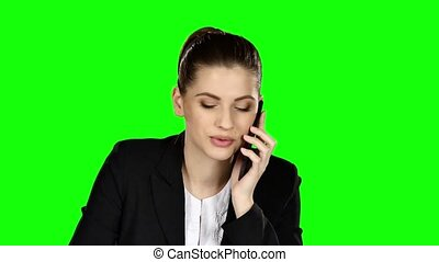 Happy businesswoman speaking at the phone. Green screen