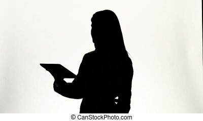 Doctor working with laptop. White. Silhouette - Doctor...