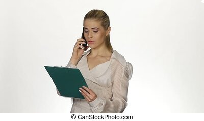 Business woman talking on the phone and makes notes White -...