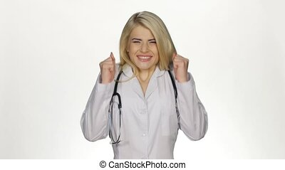 Young successful doctor showing thumbs up. White - Young...