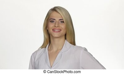 Female doctor smiling to camera. White - Female doctor...