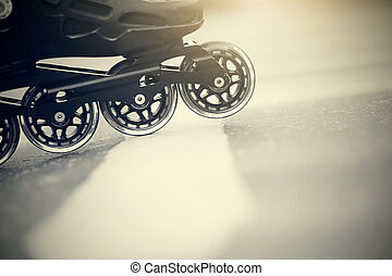 Road and wheels of roller skates closeup - Background with...