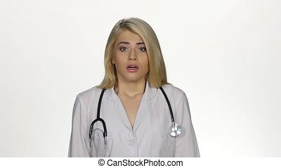 Shocked young female doctor. White. Slow motion - Medical...
