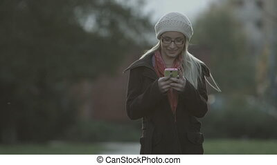 Woman sms texting on smartphone - Woman sms texting on smart...