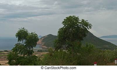 View of Separated Rural Peasant Fields against Sea Hill -...