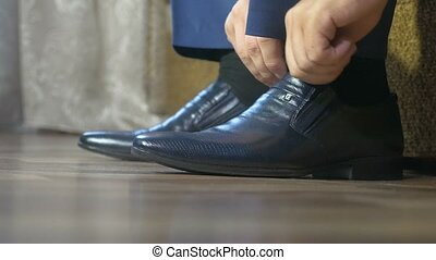 video mens shoes in black on the floor - video mens shoes in...