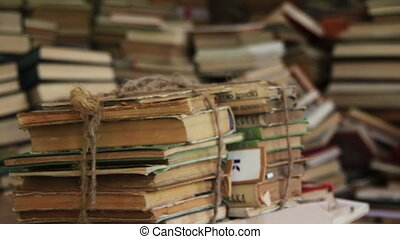 Stack of Books Scattered on the Floor in the Library - Pile...