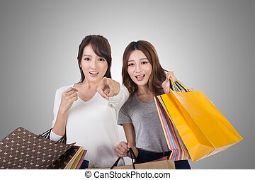 Asian shopping woman with her friends holding bags