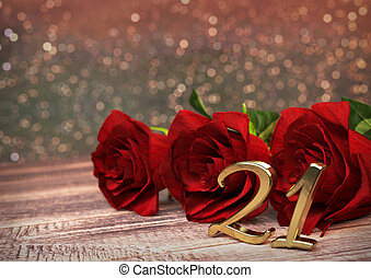 birthday concept with red roses on wooden desk. twenty-first...