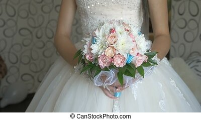 bridal bouquet of white roses and blue video colors in the lace