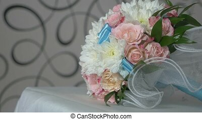 bridal bouquet of white roses and blue colors in the video...