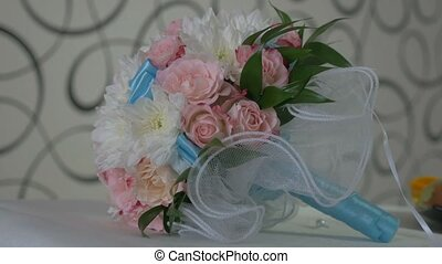 bridal bouquet of white roses and blue colors in video the lace