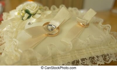 video on a cushion of lace lie rings bride and groom - video...