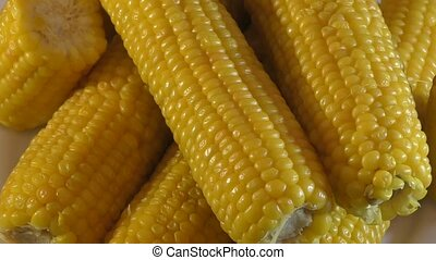 Boiled corn on the dinner table - Boiled juicy corn on the...