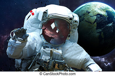 Astronaut in outer space. Spacewalk. Elements of this image...