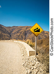 Andean road - Warning signs on a steep road crossing an...