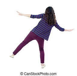 Balancing young woman or dodge falling woman Long-haired...