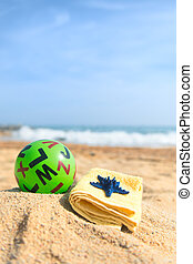 Green bal at the beach - Green toy ball with letters at the...