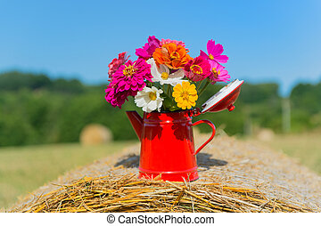 Bouquet flowers in summer - Bouquet garden flowers on hay...