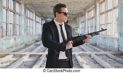 man in a suit with a shotgun - hitman reload the gun
