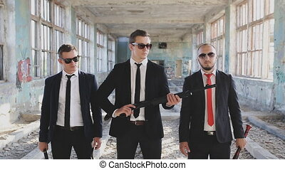 three mens with weapons in abandoned building - mafia with...