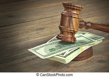 Judges or Auctioneer Gavel And Dollars Cash On Wooden Table...