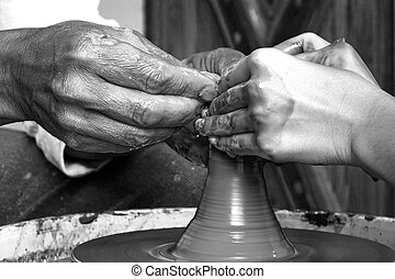 Mature Potter Hands Which Guide The Hands Of Young Woman