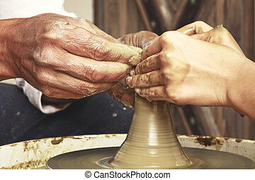 Mature Potter Hands Which Guide The Hands Of Young Woman -...