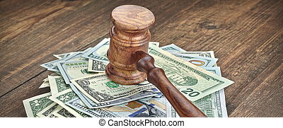Stack Of Banknotes With Judges Or Auctioneers Gavel Or...