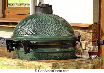Closeup Of Green Ceramic BBQ Grill Mounted In The Table...