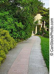 Summer Landscape In Tropical Ornamental Park With Walkway...