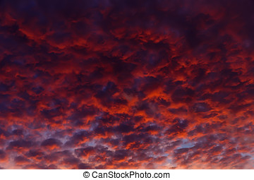 Dramatic sky at sunset, after the sun disappeared behind the...
