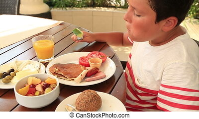 Child eating breakfast at the garde