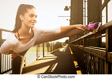 young woman streching before sports urban sport style -...