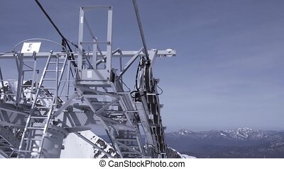 Ski resort. Construction of ski lifts. Height. Sunny day in snowy mountains