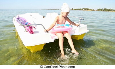 little girl on a catamaran - little girl in the sea on a...