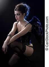 female dark angel with black wings in lingerie