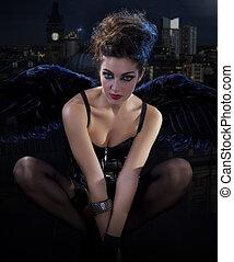 female dark angel with black wings in lingerie