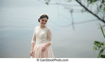 Bride posing on the river bank. Full HD